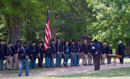 yankees: HUNTERSVILLE, NC - JUNE 6 2015:  Reenactors in Union army uniforms recreate an American Civil War battle at Historic Latta Plantation.