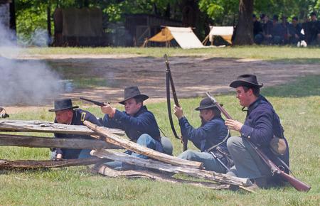 armaments: HUNTERSVILLE, NC - JUNE 6 2015:  Reenactors in Union Army uniforms recreate an American Civil War battle at Historic Latta Plantation.