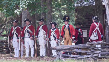 recreate: MCCONNELLS, SC - July 11, 2015:  American Revolutionary War reenactors recreate the Battle of Hucks Defeat at Historic Brattonsville.  The Patriot victory was originally fought nearby on July 12, 1780.