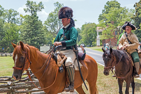 revolutionary war: MCCONNELLS, SC - July 11, 2015:  American Revolutionary War reenactors on horseback recreate the Battle of Hucks Defeat at Historic Brattonsville.  The Patriot victory was originally fought nearby on July 12, 1780.