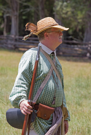 revolutionary war: MCCONNELLS, SC - July 11, 2015:  American Revolutionary War reenactor during a recreation of the Battle of Hucks Defeat at Historic Brattonsville.  The Patriot victory was originally fought nearby on July 12, 1780.
