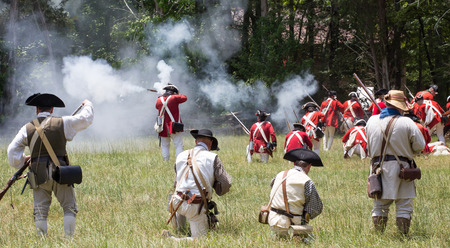 armaments: MCCONNELLS, SC - July 11, 2015:  American Revolutionary War reenactors recreate the Battle of Hucks Defeat at Historic Brattonsville.  The Patriot victory was originally fought nearby on July 12, 1780.