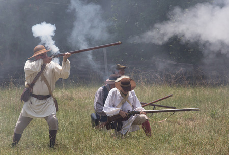 musket: MCCONNELLS, SC - July 11, 2015:  American Revolutionary War reenactors recreate the Battle of Hucks Defeat at Historic Brattonsville.  The Patriot victory was originally fought nearby on July 12, 1780.