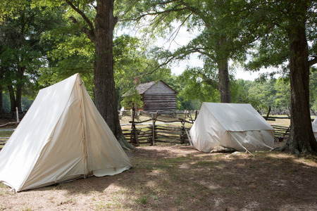 encampment: MCCONNELLS, SC - July 11, 2015:  American Revolutionary War encampment during a reenactment of the Battle of Hucks Defeat at Historic Brattonsville.  The Patriot victory was originally fought nearby on July 12, 1780. Editorial