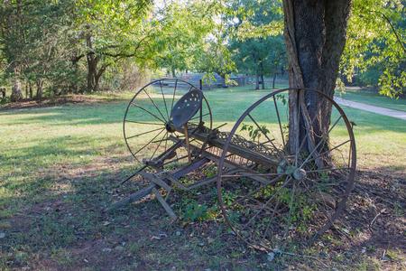 farm equipment: Old Farm Equipment in Pasture Stock Photo