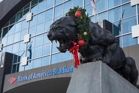 CHARLOTTE, NC - December 12, 2015: A Christmas wreath adorns a giant panthers statue outside Bank of America Stadium, home of the Carolina Panthers NFL football team.