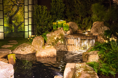 lighting: CHARLOTTE, NC- February 28, 2016:  A display of landscape architecture with dramatic night lighting at the Southern Spring Home  Garden Show. Editorial