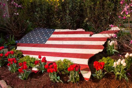 Landscape design featuring an American flag.