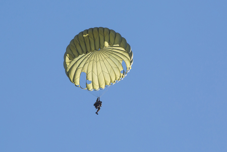 MONROE, NC - NOVEMBER 11, 2017:  A paratrooper demonstration during the Warbirds Over Monroe Air Show in Monroe, NC.