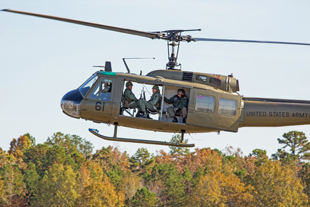 MONROE, NC - NOVEMBER 11, 2017:  A UH-1H Huey helicopter performing at the Warbirds Over Monroe Air Show in Monroe, NC.