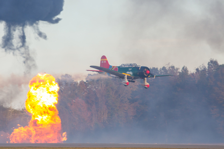 MONROE, NC - NOVEMBER 11, 2017:  Reenactment of the Japanese Attack on Pearl Harbor during Warbirds Over Monroe Air Show in Monroe, NC. Stock Photo - 90483739