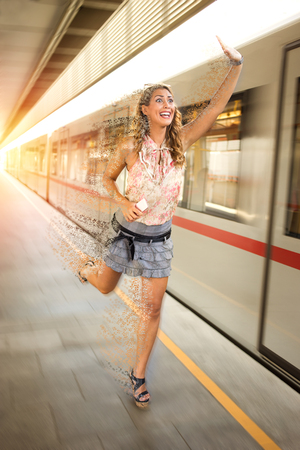 Beautiful young business woman running after the train at a subway station 版權商用圖片 - 85701028