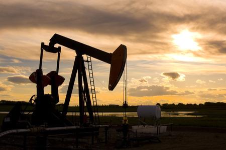 Silhouette of hard working Oil Pump Jack
