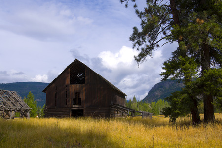 Old antique barn in a farmers field near Shuswap Lake, British Columbia,Canada