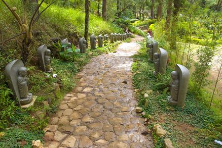 Stone Figures in Meditation in Japanese Garden
