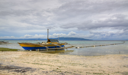 HDR of a fishing boat on the beach in Bohol, Philippines Reklamní fotografie