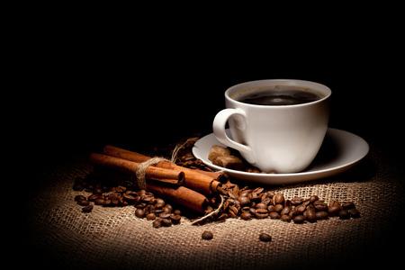 cup of cofee on sacking and cinnamon Stock Photo