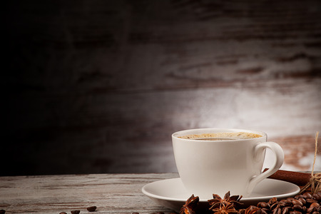coffee cup anise cinnamon over grunge wood photo