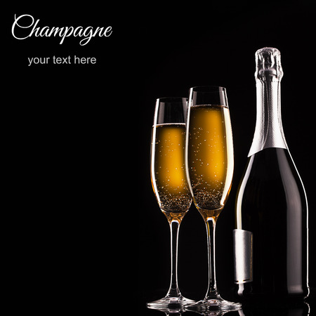 glass bottle: bottle of champagne and glasses over dark background