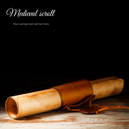 medieval scroll over grunge wooden table