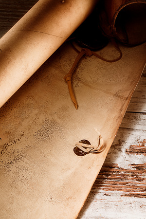 codex: medieval scroll over grunge wooden table
