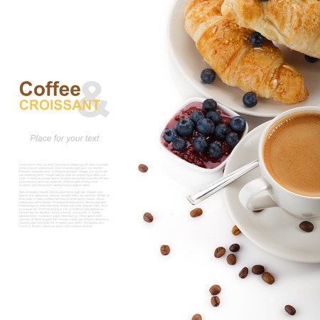 coffee with croissants and blueberries on white background photo