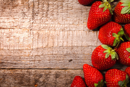 strawberries over wooden background photo