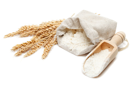wheat in bag and scoop isolated on white background Standard-Bild