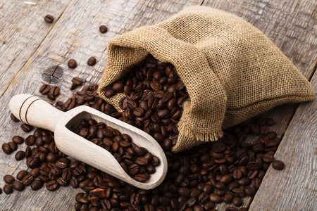 coffee bag on old wooden table and bag of coffee beans