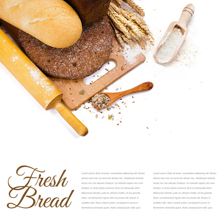 fresh bread on cutting Board, scoop with flower and seeds isolated over white photo