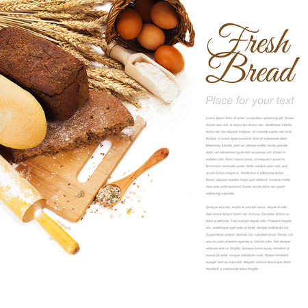 bakery: fresh bread on cutting Board, scoop with flower and seeds isolated over white