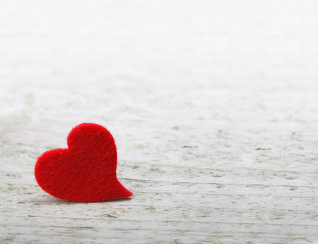 valentines day background with one heart on wooden background