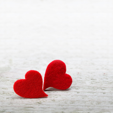 loves: valentines day background with two hearts on wooden background Stock Photo