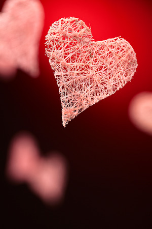 heart shaped stuff: valentines day background: hearts over red gradient