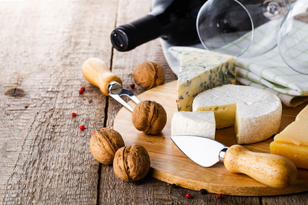 cheese knife: served cheese and wine on old wooden table
