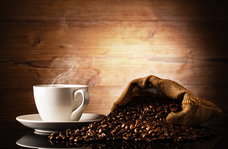 cup of coffee and backin front of wooden background photo