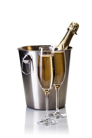 Champagne bottle in bucket with glasses of champagne isolated on white background