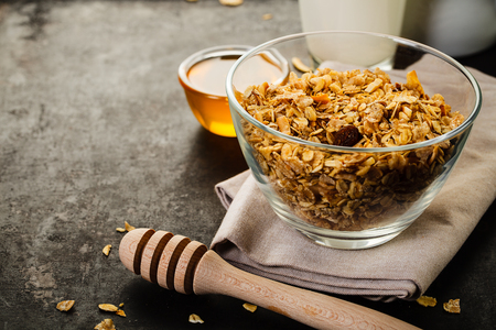 Muesli in a glass on a rusty background