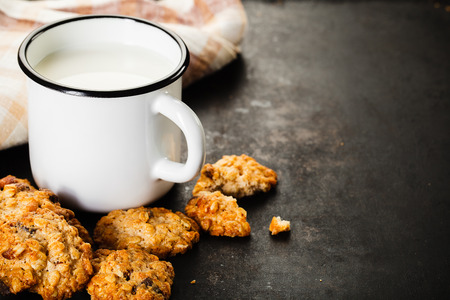 Chocolate chips cookies with nut and chocolate, milk on old rusty background