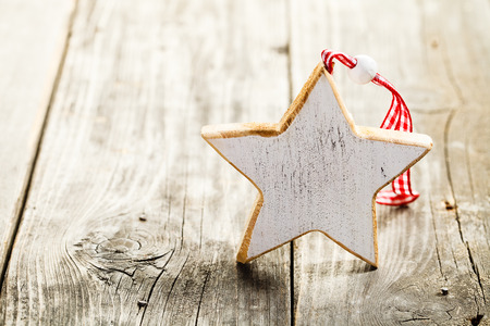 Christmas star made of wood with rope standing on wooden background