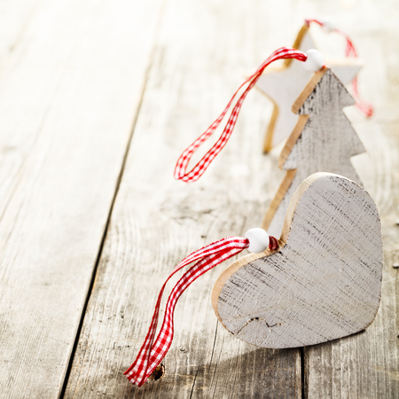 Christmas decorations made of wood with rope standing on wooden background