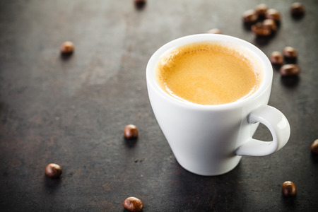 cup of espresso on old rustic background