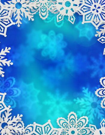 christmas background. snowflakes in front of blue blurred background
