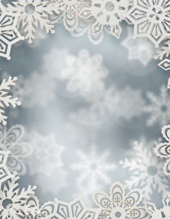 christmas background. snowflakes in front of silver blurred background