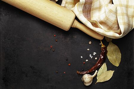 rolling pin and spices on old rustic background Standard-Bild