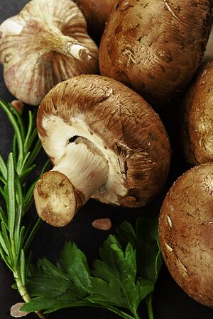 brown champignons on old rustic background