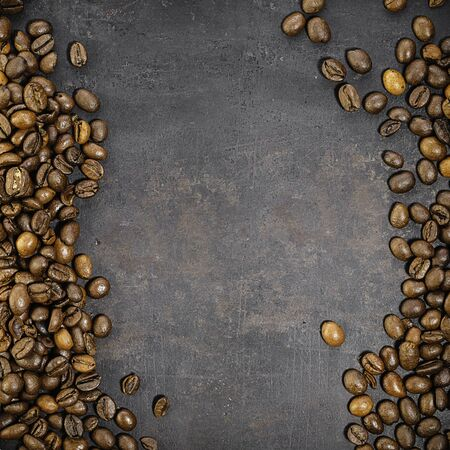 coffee beans on old rustic background.