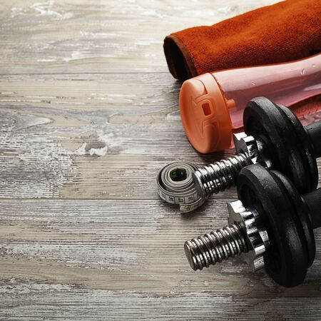 fitness equipment on wooden fllor with copy space