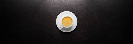 cup of coffee standing on old rustic background. Banner layout
