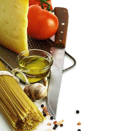 raw pasta and cooking ingredients isolated on white background